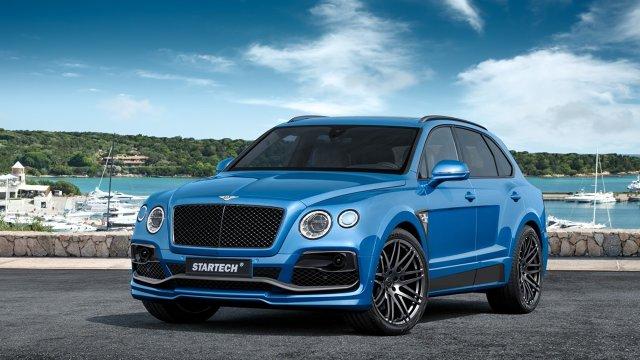 Bentley Bentayga   Zdecydowano się na przestylizowanie zderzaków oraz progów. Nad nadkolem możemy znaleźć dekoracyjny element, a dodana została także czarna listwa, która ma być namiastką spoilera. Na 25-calowe felgi nałożono opony Continental 95/35 R23.  Fot. Startech